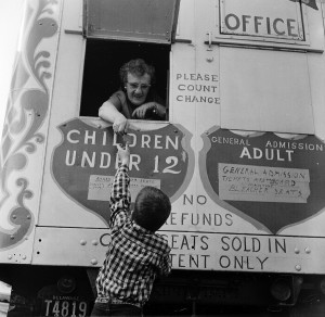 circa 1955: A young boy buying a ticket for a circus. (Photo by Vecchio/Three Lions/Getty Images)